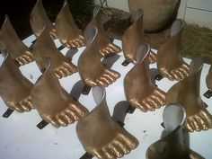 Making of the foot lights used to surround the stage of Madame Zingara's Theater of Dreams