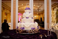 Romantic wedding cake with purple flowers and draped icing ribbon, Southern Event Planners, Memphis Weddings