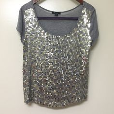HP Forever 21 shirt silver& gold sequins A fun grey shirt with silver and gold sequins all over the front. Back side is plain grey. Except for one or two sequins that fell off (see picture, hard to spot exactly where and not noticeable in real life), it is in good condition.                  HOST PICK: Off Duty Style 8/20 Forever 21 Tops