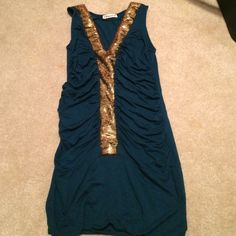 Forever 21 sequined tank Cute tank! Sequin detail gives a dressier appearance and the rouching is flattering! Forever 21 Tops Tank Tops