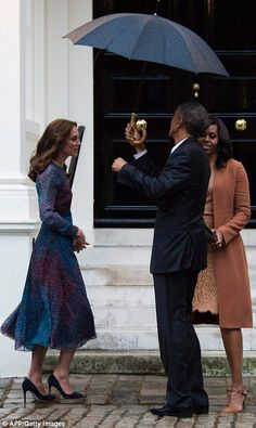 Ever the gentleman, President Obama offers his umbrella to Kate but she politely refused...