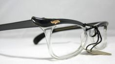 Vintage Eyelgasses. 60s Winged Cat Eye Glasses. Gray and Clear. $75.00, via Etsy.
