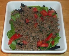 taco salad  3.5 oz Ground Beef  1 tsp Onion, minced  1 clove Garlic, minced  Spices of your choice, like cumin, chili powder, cilantro, etc.  2 cups Lettuce   1 Tomato, diced