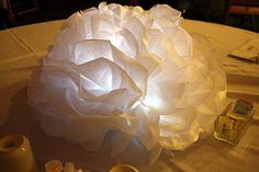 DIY Pom Pom Centerpieces using LED lights, how pretty! You could even use a colored light of your choice! Paper Flower Centerpieces, Tissue Paper Flowers, Wedding Centerpieces, Wedding Table, Diy Wedding, Wedding Decorations, Wedding Ideas, Diy Flowers, Parties Decorations