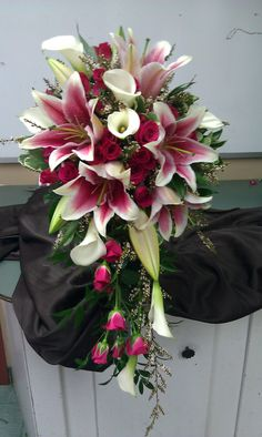 cascading bridal bouquet, lilies, calla lilies and spray roses