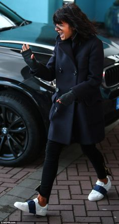 High spirits: Claudia Winkleman appeared bright-eyed and bushy tailed as she waltz her way out of the Strictly Come Dancing hotel in Blackpool on Sunday morning