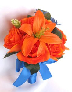~~~ US FREE SHIPPING for a limited time ~~~ If You Need Different Quantities, Different Colors or Matching Decoration Items Please Contact Us or a Custom Price Quote. This listing is for a 17 piece package including the following items: 1 Brides Cascade bouquet (9 wide by 16 long) made with Orange Lilies, Orange open roses and rosebuds, Royal blue Babys breaths, small Orange Lilies, Royal blue Peruvina, few green Hops and green leaves.The handle is wrapped in Royal blue Satin and decorated… Silk Flower Bouquets, Bride Bouquets, Silk Flowers, Cascade Bouquet, Royal Blue Wedding Decorations, Flower Decorations, Flower Ball, Diy Flower, Tiger Lily Bouquet