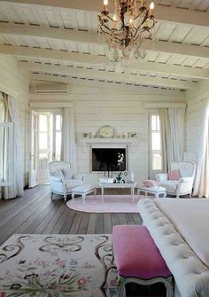 Reclaimed wood floors and white decorating with pink tones.