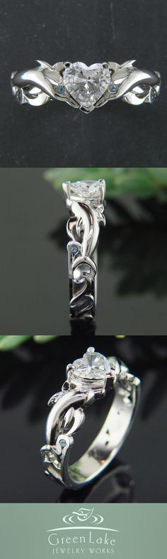 Engagement Ring - Custom dolphin ring in white gold with a stunning heart shaped center diamond and aquamarine side stones.