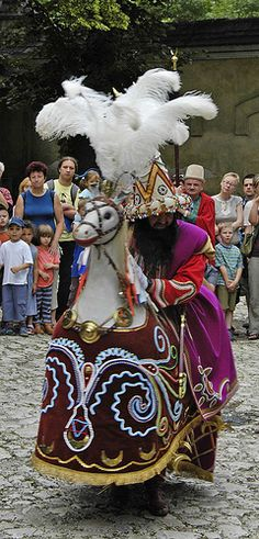 Get a bashing from the Lajkonik for good luck! Central to this quirky Polish custom is a strange looking hobby horse rider with a wizard's hat, oriental clothes and Rasputin-like beard who prances.