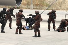 """Jordanian and US special forces take part in a hijacked plane rescue simulation at the King Abdullah Special Operations Training Centre in Amman on May 27, 2012 during their """"Eager Lion"""" military exercise which is described as the largest exercise in The way to get your body to total fitness"""