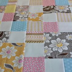 Threadbias: Daisy Cottage Quilt by Thesewingchick. The large scale blocks really showcase the lovely prints. The back is perfect too.