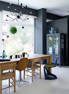 Love the colour scheme! Gun metal blue/charcoal walls with oak, white...yum! Colorful Scandinavian Home with Styling by Dennis Valencia.  Paint from Farrow & Ball.