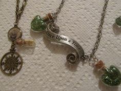 "Once Upon A Time Peter Pan themed necklaces  Compass Necklace and ""Once Upon A Time"" Necklace with pixie dust."