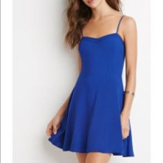 NWOT F21 Blue Cutout Dress This adorable blue dress has triangle cutouts in the back. It has a black zipper up the back as well. I've never worn it, and it is in perfect condition! Forever 21 Dresses Mini