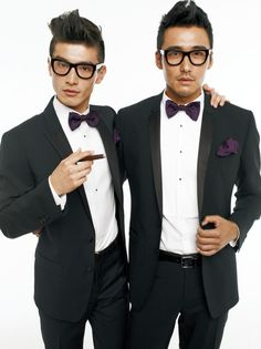 holiday styling : charcoal suit + white tuxedo shirt + purple bow ties & handkerchief + think black frames