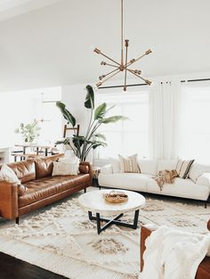 Home Tour: Mid-Century Modern Meets Boho | The Everymom, Home Design, Home Decor, Home Inspo, Mid-Century, Boho, Interior, Interior Design, Home Style, Home Tour, Modern, Mid-Century Modern, Family-Friendly, Kid-Friendly, Family Room, Master Bedroom, Kids Rooms, Kids Spaces, Living Room, Entryway