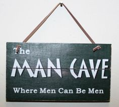"""This collectible wooden sign / Christmas ornament reads """"""""The Man Cave: Where Men Can Be Men."""""""" Sign measures 3"""""""" x 6"""""""" and makes a manly addition to the decor of the den, lodge, home, or weekend geta"""