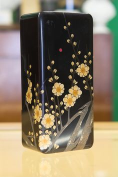 """Beautiful hand painted wooded Japanese lacquer box with sakura cherry blossom motif, including silver paint. Dates to mid Taisho period. Excellent condition for it's age. Measures 9.5"""" x 4.5"""" x 3""""."""