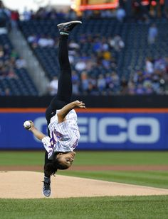 United States Olympic Gymnastics gold medalist Laurie Hernandez does a flip as she throws out the first pitch before a game between the Washington nationals and New York Mets at Citi Field on September 3, 2016 in the Flushing neighborhood of the Queens borough of New York City.