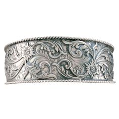 A hand engraved, solid sterling cuff bracelet framed with a hand twisted sterling rope edge and hand cut applied sterling scrolls. The applied silver scroll on a silver background gives the bracelet a very deep, three-dimensional look and feel