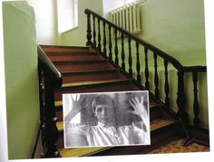 The stairs in the Governor's Mansion in Tobolsk. Alexei was so bored by being confined that he tobogganed down them one day, only to be struck down with his worst hemophilia attack since Spala in 1912. He never walked again.     The photograph of Alexei within the larger photograph was taken during his last illness, but was not the last photograph ever taken of him.