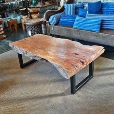 Organic edge, reclaimed teak slab coffee table with brushed iron modern legs. A beautiful addition to both modern and eclectic interiors or covered out door spaces. Wood Slab Table, Wood Table Design, Dining Table Legs, Walnut Table, Coffee Table Images, Coffee Tables For Sale, Rustic Coffee Tables, Natural Wood Coffee Table, Accent Table Decor