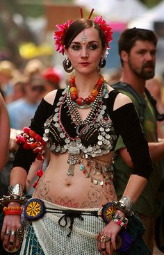 Tribal belly dance costumes are colourful, from the flowers and feathers in their hair to the flowing skirts - not to mention the exotic tattoos in between!