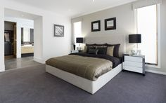 Grey carpet, windows on either side of bed