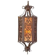 1920s Large Scale Spanish Revival Pendant with Mica   From a unique collection of antique and modern chandeliers and pendants  at https://www.1stdibs.com/furniture/lighting/chandeliers-pendant-lights/