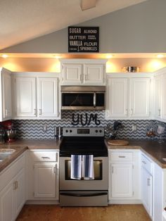 Shelf liner backsplash...this would be perfect in our base house, lots of impact and its removable!!!