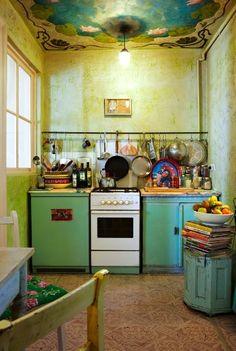 Bohemian. I pinned this for the ceiling and the colors. Not sure why they put that pot bar so low though...