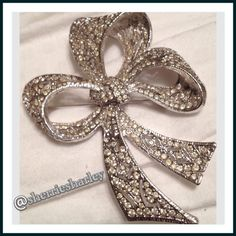 "TIMELESS CRYSTAL BOW BROOCH  Classy & Timeless CRYSTAL BOW Brooch to dress up for any occasion... Or just because.  Features a clasp back and gorgeous inlaid crystals in this intricate ribbon style bow.  Approximate size is 3"" X 3"". NEW  Jewelry Brooches"