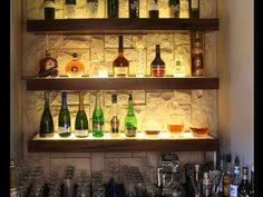 Floating shelf concept for the bar. Maybe just display one of each thing they have? Then everything is stored in the lockable cabinets at night Bookcase Bar, Bar Shelves, Glass Shelves, Floating Shelves, Shelving Ideas, Wood Shelves, Diy Home Bar, Bars For Home, Bar A Vin