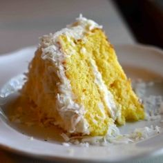 Piña Colada Cake!! A moist pineapple cake with a fluffy cream cheese coconut frosting. Add some rum for the real deal!