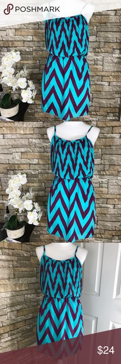 "Poema Purple and Blue Chevron Sleeveless Dress Beautiful Poema dress perfect for Spring and Summer. Fully lined. Chevron print throughout. Materials 100% Polyester.   Size  S  Measurements (laid flat) Armpit to armpit 15.5"" Waist 14"" Length 32.5"" from top of shoulder    Condition Excellent preowned condition. No flaws noted. Poema Dresses"
