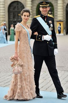 At the marriage of Crown Princess Victoria of Sweden, the future queen knows a nude gown is just right for a summer wedding. Subtle floral embellishment adds an interesting twist.   - HarpersBAZAAR.com