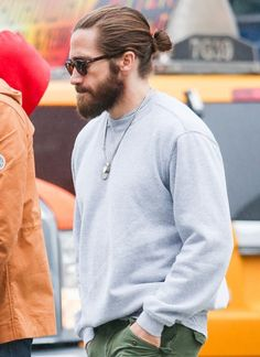 These celebrities are rocking the man bun look and beating the heat in style!