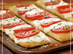 Caprese Pizza....an easy way to do this, would be to get the garlic, basil pizza dough from trader joes, which is seriously like $1.50, so easy and so cheap