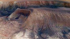 AstronomyPictureOfTheDay  Collapse in Hebes Chasma on Mars (2014 Aug 12)