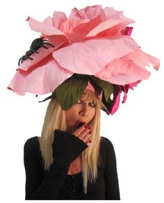 Any sporting event that features its own fancy signature cocktail and an excuse to wear a fabulous hat is one we can get behind, which is why we're so excited about this weekend's 137th running of the Kentucky Derby. So's designer Betsey Johnson, who's attending for the first time and shared her hot headwear tips with us!