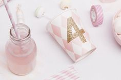 DIY glitter numbers on a pink paper party cup - perfect for a Cinderella princess party!