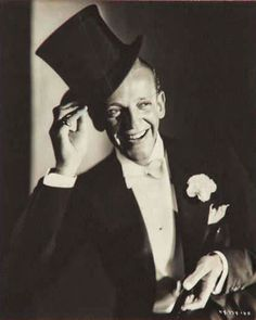 Fred Astaire in his prime - studio shot. His signature top hat, white tie and tails.