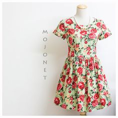 This is a super cute floral sundress. Light green with big red roses print. Made of high quality Japanese cotton. A summer must have! Bodice is fitted and waist is gathered to create a nice fullness to the skirt without petticoat. Zipper at center back. Skirt is lined with two hidden side pockets. Available in S, M & L. Check out more details at www.mojonet.etsy.com