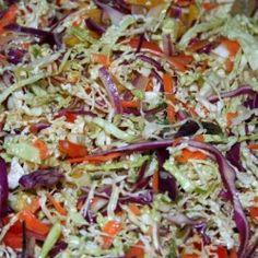 Whole vegetables, sesame seeds, an orange, vinegar, and sesame oil make up this awesome slaw.
