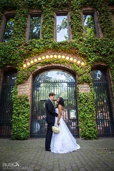 Bride and groom in Pioneer Square.  Seattle Wedding Photographer Laura Marchbanks Photographs a couple at the Fairmont Olympic Seattle and Magnolia Church of Christ, First look and bridal party in Pioneer Square