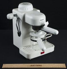 KRUPS 4 CUP EXPRESSO MACHINE IN WHITE. EVERYTHING SEEMS TO BE INTACT.