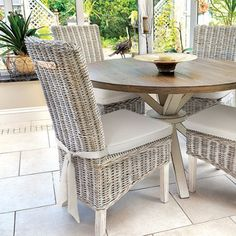 A Pair of Grey Wash Rattan Dining Chairs with Cream Cushion Rustic Wooden Table, Farmhouse Dining Chairs, Wicker Chairs, Dining Chair Cushions, Wooden Dining Tables, Dining Room Chairs, Dining Room Furniture, Rustic Furniture, Swivel Chair
