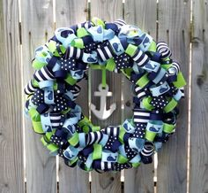 Just bought this Whale ribbon wreath for the nursery! (by TheEducatedOwl on Etsy)