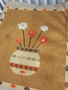Crib quilt La Royale This cotton crib comforter will add color, style and elegance to any baby's nursery. The flowers are made with felt fabric and hand sewn. Included flower pillow could also be used on an ottoman or nursery recliner.